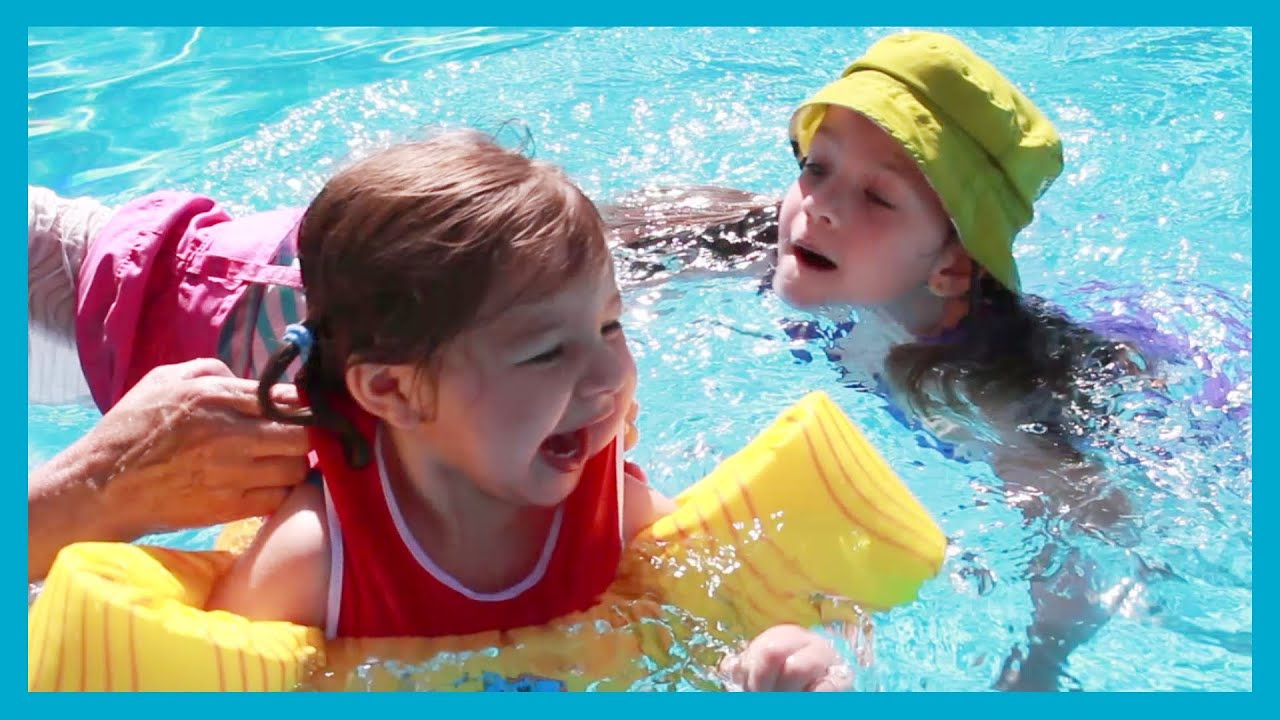 Kids swim in the swimming pool girls playing vlog water for Kids swimming pool