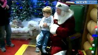 Santa uses sign language with deaf boy