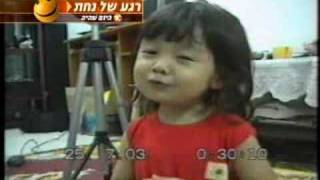 Cute Asian girl singing a song