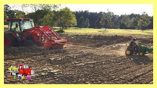 Powered Ride On John Deere Tractor Pulling The Stuck Kubota Tractor Help From The CAT Track Loader