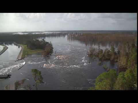 Sutton cooling lake breach flows into Cape Fear River; Sutton combined cycle plant in backdrop. 9/22 morning inspection.