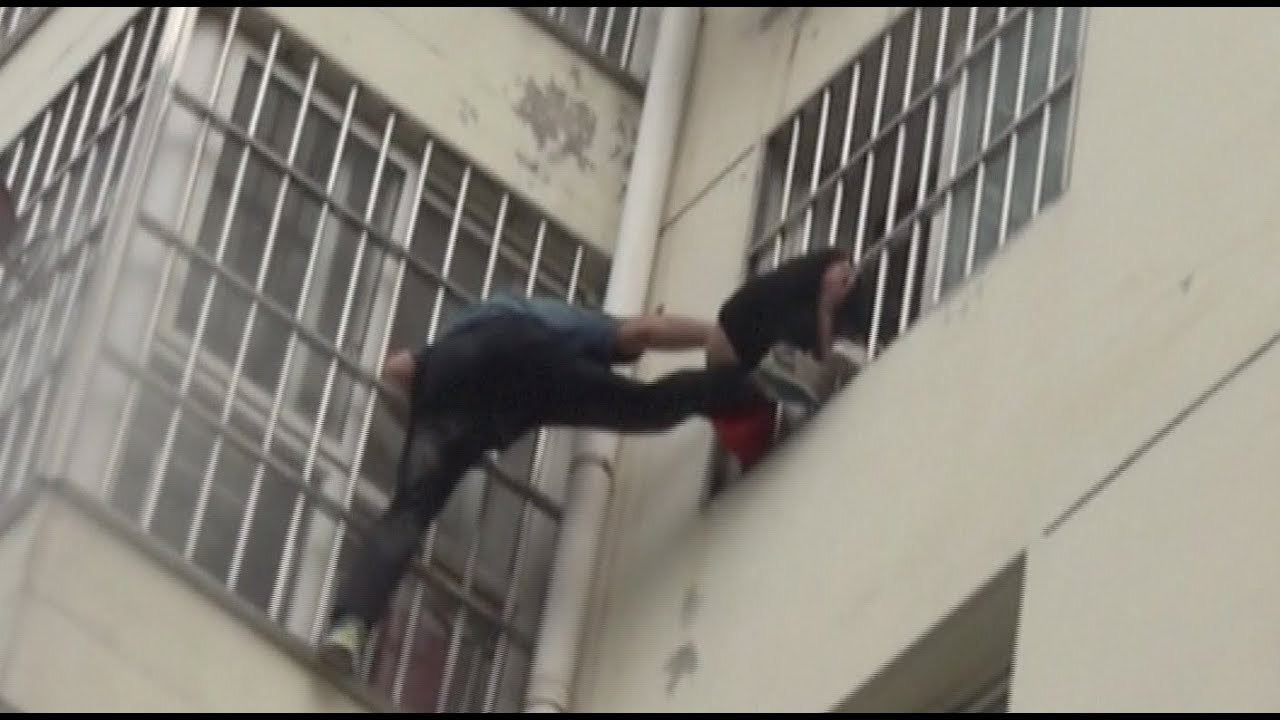 Man, Firefighters Rescue Girl from Window Bars