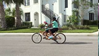 Debra & Alana riding their Buddy Bike