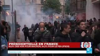 Scènes d'affrontements à Paris entre manifestants et forces de l'ordre après la victoire d'E. Macron