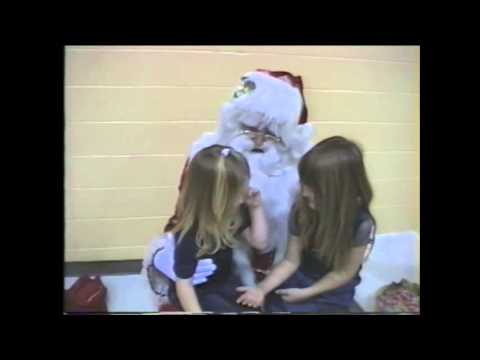 Santa makes little girls kiss!