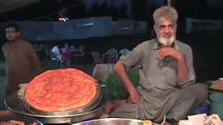 how-to-make-katlama-or-how-to-make-punjabi-pizza-in-village-fair