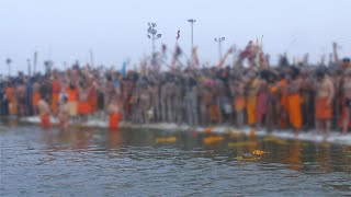 Indian sadhus throwing flower garlands in the holy water of the river Ganga