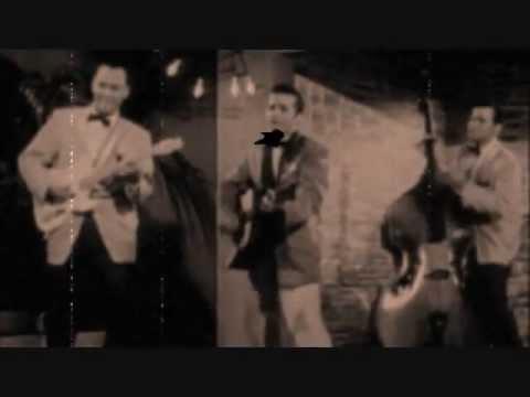 Johnny Burnette Trio - The Train Kept A Rollin'