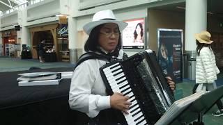Accordion Liz in Tux at D1  PDX Int'l Airport  May 20, 2017 thumbnail