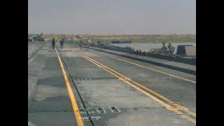 أخبار عربية - جسر الموصل العائم السبيل الوحيد للسكان لبناء حياة جديدة