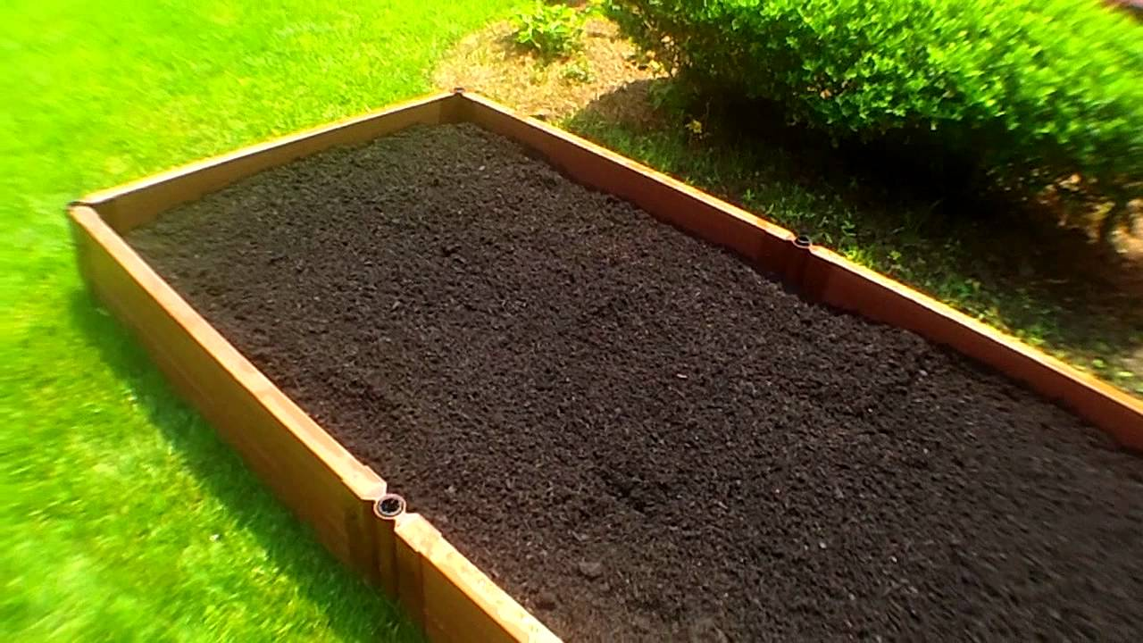 Raised bed organic vegetable gardening planting with deep for Garden topsoil