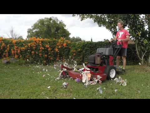 Shredding newspapers with a commercial lawn mower