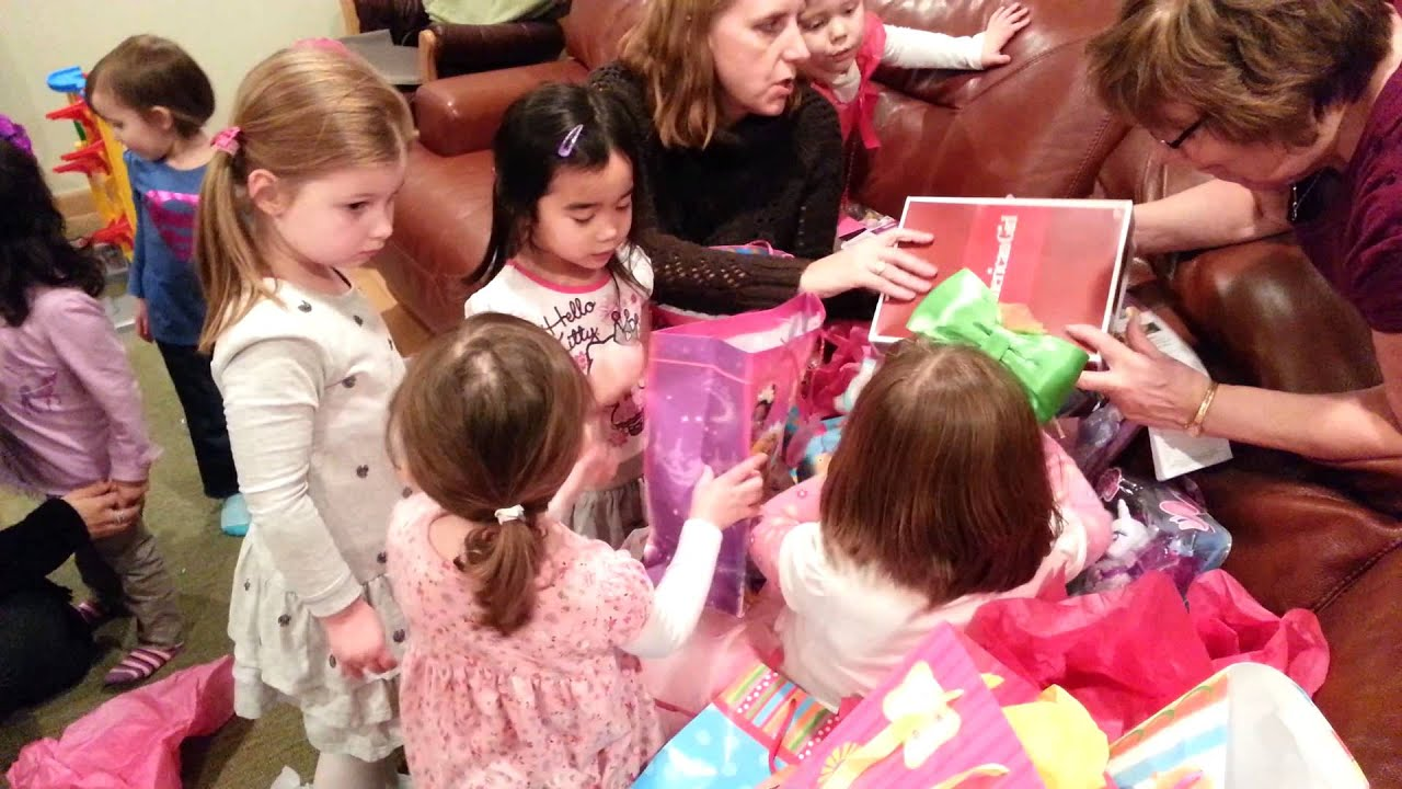 Kids opening birthday presents