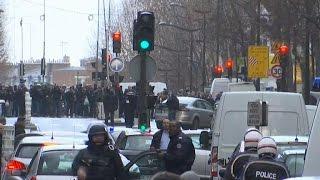 Paris police shoot man with possible suicide belt