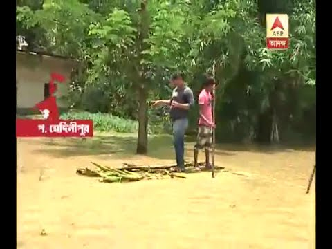 A large are of Ghatal, Daspur still under water, here
