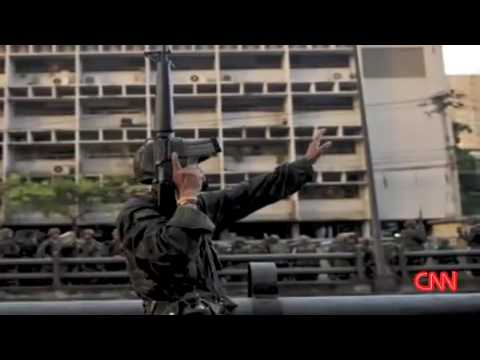 CNN REPORT Thai riot police clash with protesters 13 04 2009