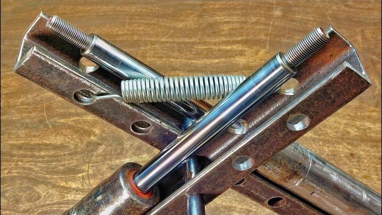 Шикарное применение старых амортизаторов! Для гаража или мастерской!
