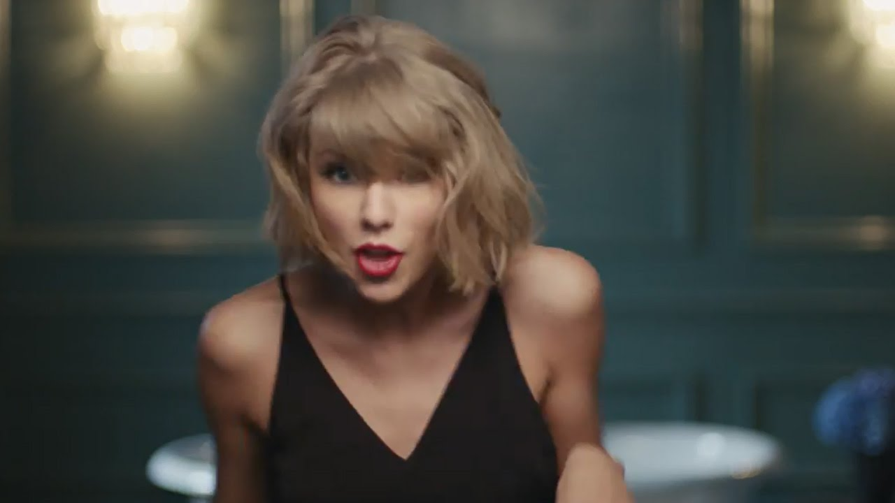 a review of two commercials by apple music featuring taylor swift