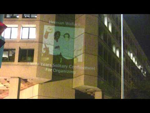 Truth To Power: Guerilla Projection on FBI Headquarters Highlighting Suppression of Dissent