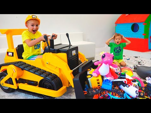 Vlad and Nikita play with toys ride on excavator