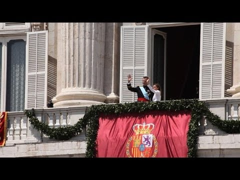 Flags, cheers greet Spain's new King Felipe VI