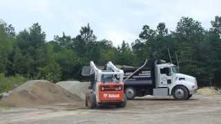 Bobcat A770 Loading Dump Truck