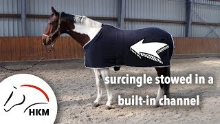 Fleece rug with surcingle in a built-in channel | HKM Sports Equipment