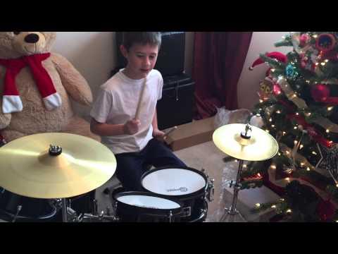 Ian gets a drum set for Christmas.