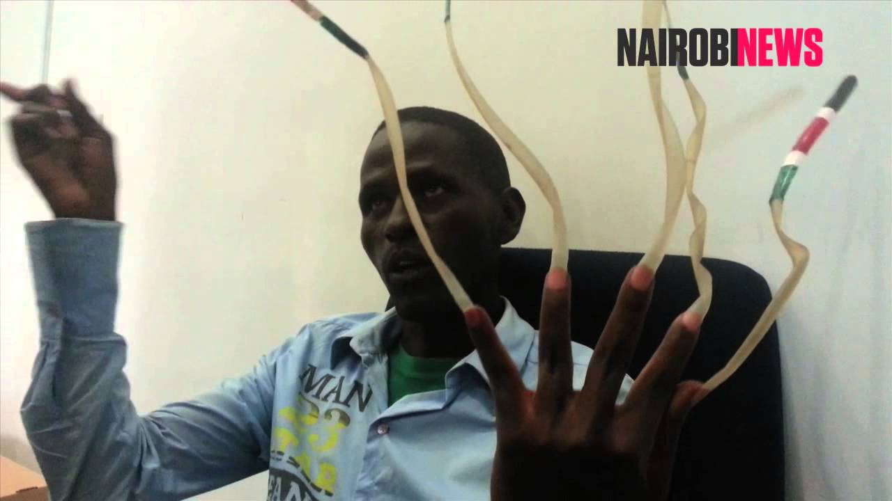Man with longest nails targets world record - YouTube