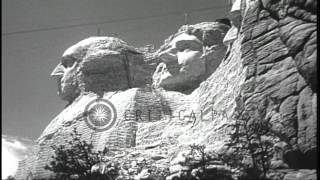 Sculptors sculpt heads of George Washington, Theodore Roosevelt, Abraham Lincoln ...HD Stock Footage