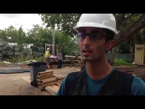 Graduate students help construct pedestrian bridge at UM