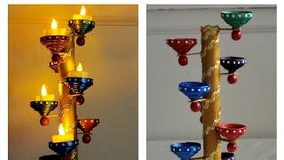 DIY diya stand. Easy Diwali decoration. Easy Newspaper diya stand.