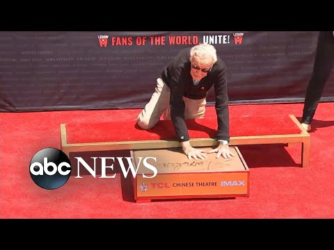 Stan Lee imprints his hands and feet in cement at TCL Chinese Theatre
