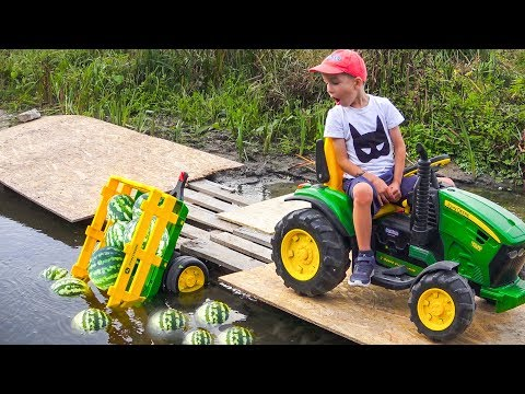 Darius rides on Tractor Power Wheels and the Truck fell into the water Riding on Truck Toys