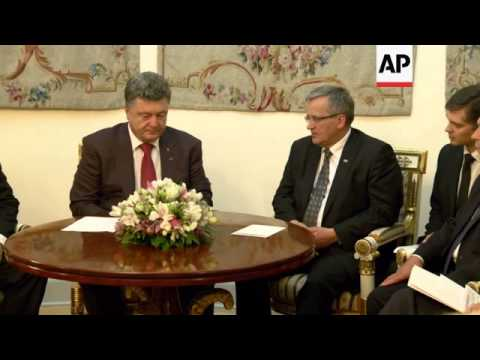 Poroshenko meets counterpart as he begins his first foreign trip