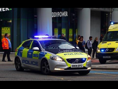 London Metropolitan Police Car Escorting Ambulance