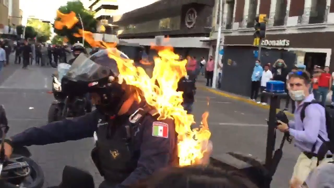 Police officer set on fire during protests in Mexico