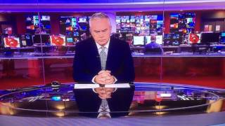 Huw Edwards on BBC News - Several minutes of silence before the 10p...