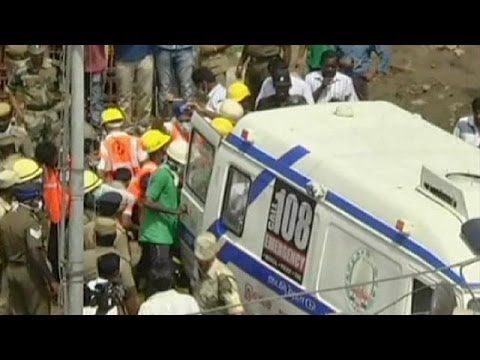 India: man pulled from rubble of collapsed building