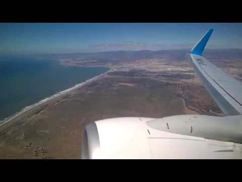 Landing and take off by boeing 737 in Agadir Wing view shadow