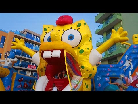 Outdoor playground for kids with BOB SPONGE, sliders and more funny inflatable toys