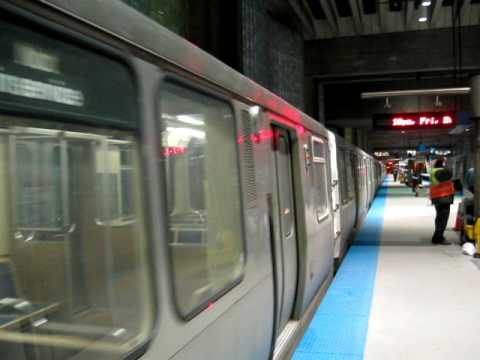 CTA train ( Chicago ) arriving in airport ( O'Hare ) station