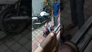 Funny babies drive bikes