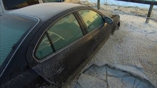 Cars frozen solid to the ground