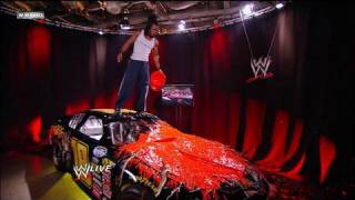 Kofi Kingston defaces Randy Ortons gift.