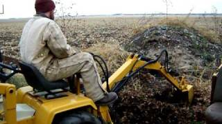 cub cadet backhoe in action