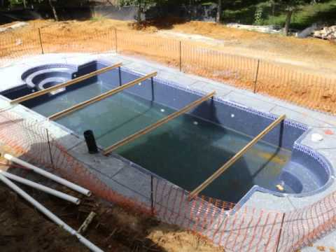 Viking fiberglass pool installation 15 concrete youtube for Fiberglass pool installation