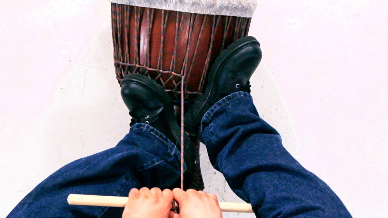 hight resolution of how to tune a djembe african drums