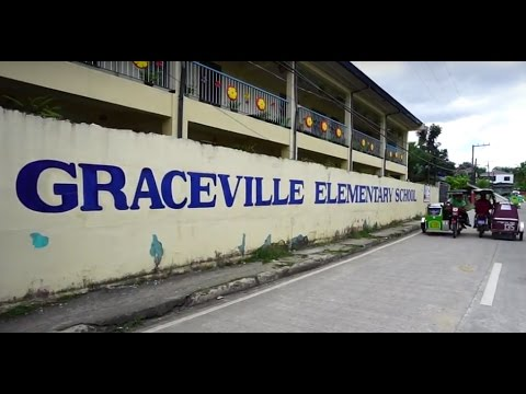 Philippines, Bulacan, walking around and buying street food next to Graceville Elementary School