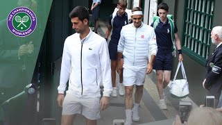 Roger Federer and Novak Djokovic walk onto Centre Court for Wimbledon 2019 Final